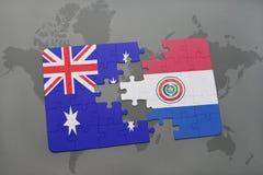 förbrylla med nationsflaggan av Australien och Paraguay på en världskartabakgrund Arkivbild