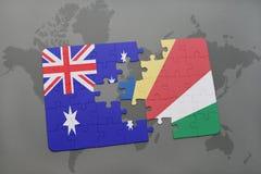 förbrylla med nationsflaggan av Australien och Seychellerna på en världskartabakgrund Royaltyfri Bild