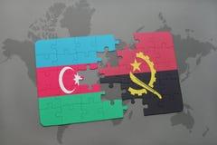 förbrylla med nationsflaggan av Azerbajdzjan och Angola på en världskarta Arkivbild