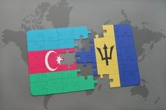 förbrylla med nationsflaggan av Azerbajdzjan och Barbados på en världskarta Arkivbild