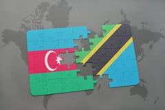 förbrylla med nationsflaggan av Azerbajdzjan och Tanzania på en världskarta Royaltyfri Fotografi