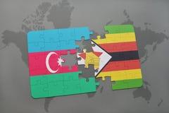 förbrylla med nationsflaggan av Azerbajdzjan och Zimbabwe på en världskarta Arkivbilder