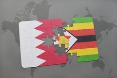 förbrylla med nationsflaggan av Bahrain och Zimbabwe på en världskartabakgrund Royaltyfri Bild