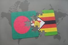förbrylla med nationsflaggan av Bangladesh och Zimbabwe på en världskarta Arkivbilder