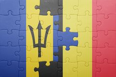 förbrylla med nationsflaggan av Barbados och Belgien Arkivfoton