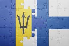 förbrylla med nationsflaggan av Barbados och Finland Royaltyfri Fotografi