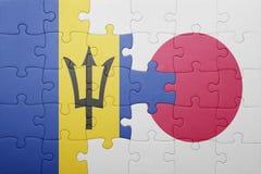 Förbrylla med nationsflaggan av Barbados och Japan Royaltyfri Foto