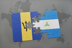 förbrylla med nationsflaggan av Barbados och Nicaragua på en världskartabakgrund Arkivfoto