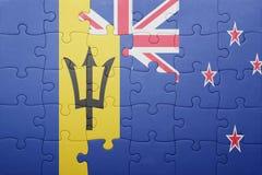 Förbrylla med nationsflaggan av Barbados och Nya Zeeland Royaltyfri Bild