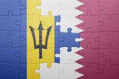 förbrylla med nationsflaggan av Barbados och Qatar Royaltyfria Bilder