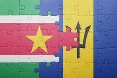 Förbrylla med nationsflaggan av Barbados och Surinam Fotografering för Bildbyråer