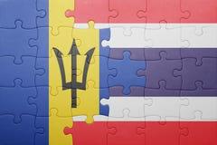 förbrylla med nationsflaggan av Barbados och Thailand Arkivbilder