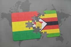 förbrylla med nationsflaggan av Bolivia och Zimbabwe på en världskarta Fotografering för Bildbyråer