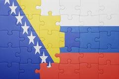 Förbrylla med nationsflaggan av Bosnien och Hercegovina och Ryssland Fotografering för Bildbyråer