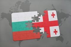förbrylla med nationsflaggan av Bulgarien och georgia på en världskartabakgrund Arkivbild
