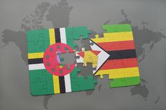 förbrylla med nationsflaggan av Dominica och Zimbabwe på en världskarta Fotografering för Bildbyråer