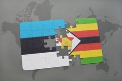 förbrylla med nationsflaggan av Estland och Zimbabwe på en världskarta Fotografering för Bildbyråer