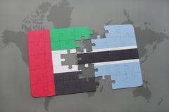 förbrylla med nationsflaggan av Förenade Arabemiraten och Botswana på en världskarta Royaltyfri Bild