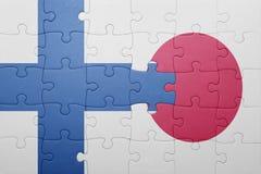 Förbrylla med nationsflaggan av Finland och Japan Royaltyfria Bilder