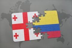 förbrylla med nationsflaggan av georgia och Colombia på en världskarta Arkivfoto