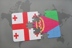 förbrylla med nationsflaggan av georgia och eritrea på en världskarta Arkivfoton