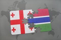 förbrylla med nationsflaggan av georgia och Gambia på en världskarta Royaltyfria Foton