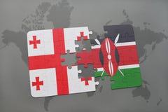 förbrylla med nationsflaggan av georgia och Kenya på en världskarta Royaltyfri Bild