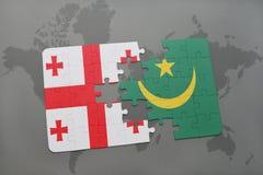 förbrylla med nationsflaggan av georgia och Mauretanien på en världskarta Royaltyfri Bild