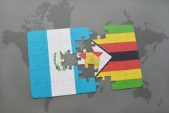 förbrylla med nationsflaggan av Guatemala och Zimbabwe på en världskarta Royaltyfri Fotografi