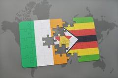 förbrylla med nationsflaggan av Irland och Zimbabwe på en världskarta Royaltyfri Foto
