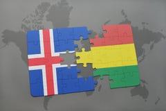 förbrylla med nationsflaggan av Island och Bolivia på en världskarta Royaltyfria Bilder