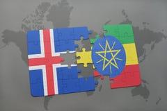förbrylla med nationsflaggan av Island och Etiopien på en världskarta Royaltyfri Bild