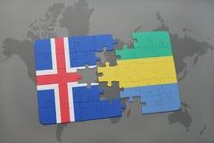 förbrylla med nationsflaggan av Island och Gabon på en världskarta Arkivbild