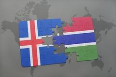 förbrylla med nationsflaggan av Island och Gambia på en världskarta Arkivbild