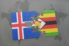 förbrylla med nationsflaggan av Island och Zimbabwe på en världskarta Arkivfoto