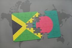 förbrylla med nationsflaggan av Jamaica och Bangladesh på en världskarta Royaltyfria Foton