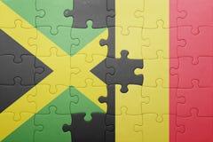 förbrylla med nationsflaggan av Jamaica och Belgien Royaltyfri Bild
