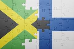 förbrylla med nationsflaggan av Jamaica och Finland Arkivbild
