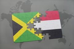 förbrylla med nationsflaggan av Jamaica och Jemen på en världskarta Arkivbilder