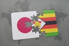 förbrylla med nationsflaggan av Japan och Zimbabwe på en världskartabakgrund Royaltyfri Foto