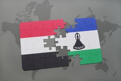förbrylla med nationsflaggan av Jemen och Lesotho på en världskarta Arkivbilder