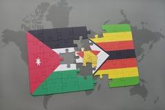förbrylla med nationsflaggan av Jordanien och Zimbabwe på en världskartabakgrund Fotografering för Bildbyråer