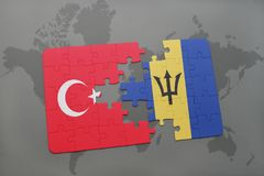 förbrylla med nationsflaggan av kalkon och Barbados på en världskarta Arkivfoto