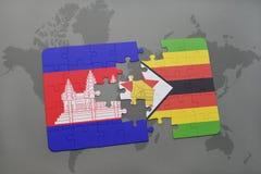 förbrylla med nationsflaggan av Kambodja och Zimbabwe på en världskarta Royaltyfri Bild