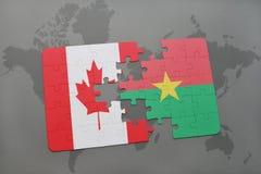 förbrylla med nationsflaggan av Kanada och Burkina Faso på en världskartabakgrund Royaltyfri Bild