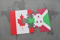 förbrylla med nationsflaggan av Kanada och Burundi på en världskartabakgrund Royaltyfri Bild