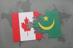 Förbrylla med nationsflaggan av Kanada och Mauretanien på en världskartabakgrund Royaltyfri Foto