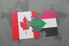 förbrylla med nationsflaggan av Kanada och Sudan på en världskartabakgrund Royaltyfria Bilder