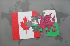 förbrylla med nationsflaggan av Kanada och Wales på en världskartabakgrund Arkivbild