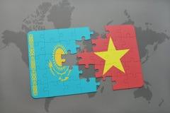 förbrylla med nationsflaggan av kazakhstan och Vietnam på en världskarta Royaltyfria Bilder